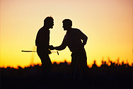 SEVE BALLESTEROS AND Jose Maria OLAZABAL<br />  AT THE END OF THE SECOND DAY CONGRATULATE EACH OTHER AFTER GAINING A HALF ON SATURDAY EVENING ON THE 18TH GREEN AS THE SUN SETS.<br /> 910921 \ KIAWAH ISLAND, SOUTH CAROLINA<br /> USA  1991<br /> <br /> <br /> Golf Pictures Credit by: Mark Newcombe / visionsingolf.com