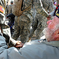 12-21-06--METRO--BARSTOW--BN21-MARCH--FT IRWIN--VETERANS--California Veterans Home resident Bill Jackson gives a warm welcome to U.S. Army troops of the 11th Armored Cavalry Regiment from the National Training Center at Fort Irwin during theri visit to the home, Thursday, Dec., 21, 2006. Eric Reed/Staff photographer