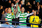 Scott Brown (#8) of Celtic and Mikael Lustig (#23) of Celtic lift the Betfred Cup following Celtic's 1-0 victory during the Betfred Cup Final between Celtic and Aberdeen at Celtic Park, Glasgow, Scotland on 2 December 2018.