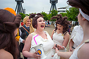 UNITED KINGDOM, London: 25 May 2018 Cosplay fans share a joke outside of the MCM London Comic-Con this afternoon. The three day comic convention, which is held at London's ExCeL, will see thousands of visitors many of them in cosplay, dressed as their favourite super hero, villain or comic book character. Rick Findler  / Story Picture Agency