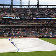 Ground staff prepare the field after a rain delay before the New York Mets V Arizona Diamondbacks Major League Baseball game  at Citi Field, Queens, New York. USA. 3rd July 2013. Photo Tim Clayton