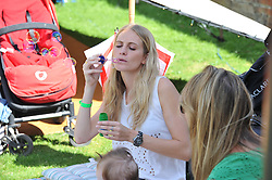 POPPY DELEVIGNE at a cricket match to in aid of CARE - Corfu Animal Rescue Establishment held at Hawkley Cricket Club, Hawkley, Hampshire on 8th September 2012.