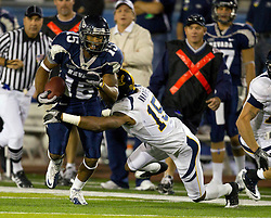 September 17, 2010; Reno, NV, USA; Nevada Wolf Pack wide receiver Rishard Matthews (left) is tackled by California Golden Bears cornerback Bryant Nnabuife (right) during the second quarter at Mackay Stadium. Nevada defeated California 52-31.