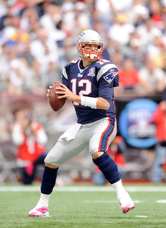 FOXBORO, MA - OCTOBER 04: Tom Brady #12 of the New England Patriots drops back to pass against the Baltimore Ravens at Gillette Stadium on October 4, 2009 in Foxboro, Massachusetts. The Patriots defeated the Ravens 27 to 21. (Photo by Rob Tringali) *** Local Caption *** Tom Brady