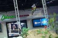Day in the life of Vicki Golden at Motocross events in Las Vegas, NV - It's barely noon and Golden is making initial passes over the freshly completed Step Up jump inside the arena.