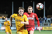 Rhys Healey of Newport County and Brad McGowan of Alfreton Town during the The FA Cup match between Newport County and Alfreton Town at Rodney Parade, Newport, Wales on 15 November 2016. Photo by Andrew Lewis.