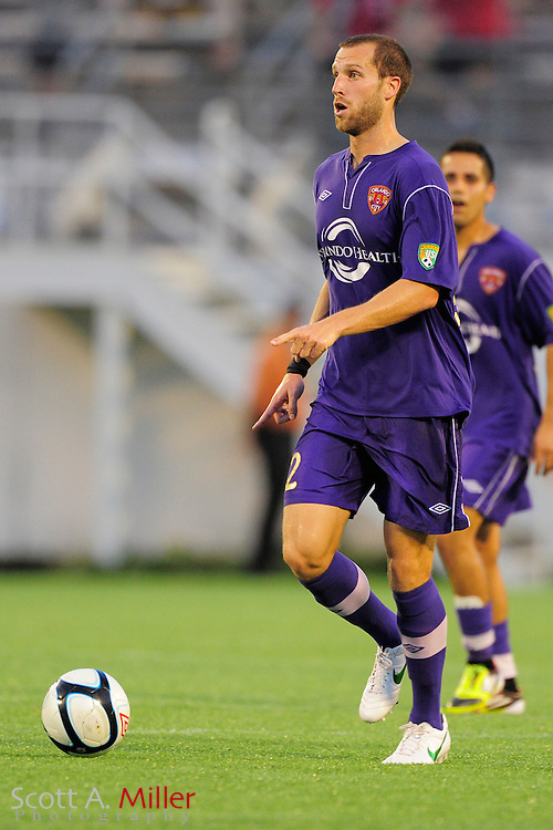 Orlando City Lions midfielder Luke Boden (14) brings the ball upfield against the Wilmington Hammerheads at the Florida Citrus Bowl on July 25, 2012 in Orlando, Florida. ..©2012 Scott A. Miller