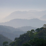 The sun rising over the primary forest valleys of Kaeng Krachan National Park, Thailand.