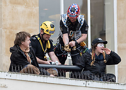 May 4, 2017 - Bristol, Bristol, UK - Bristol, UK. Anti-fracking protest. Activists from 'Rising Up' lock themselves together with their arms in a tube on top of Barclays Bank in Broadmead shopping centre. Police removed the two protestors with help from the fire brigade's turntable ladder, and both rooftop protestors were arrested plus another person was arrested on suspicion of writing slogans using chalk on the pavement. The protest is a prelude to Global Divestment in Fossil Fuels day on Friday 05 May and 06 May. (Credit Image: © Simon Chapman/London News Pictures via ZUMA Wire)
