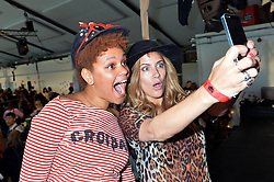 Caroline Flack and Gemma Cairney take a selfie at the Rumble In The Jumble #3, a charity jumble sale hosted by Gemma Cairney at the Oval in Bethnal Green, London, UK, in association with Oxfam in aid of abused women in the Democratic Republic of the Congo. <br /> <br /> Saturday, 26th April 2014.<br /> Picture by Ben Stevens / i-Images