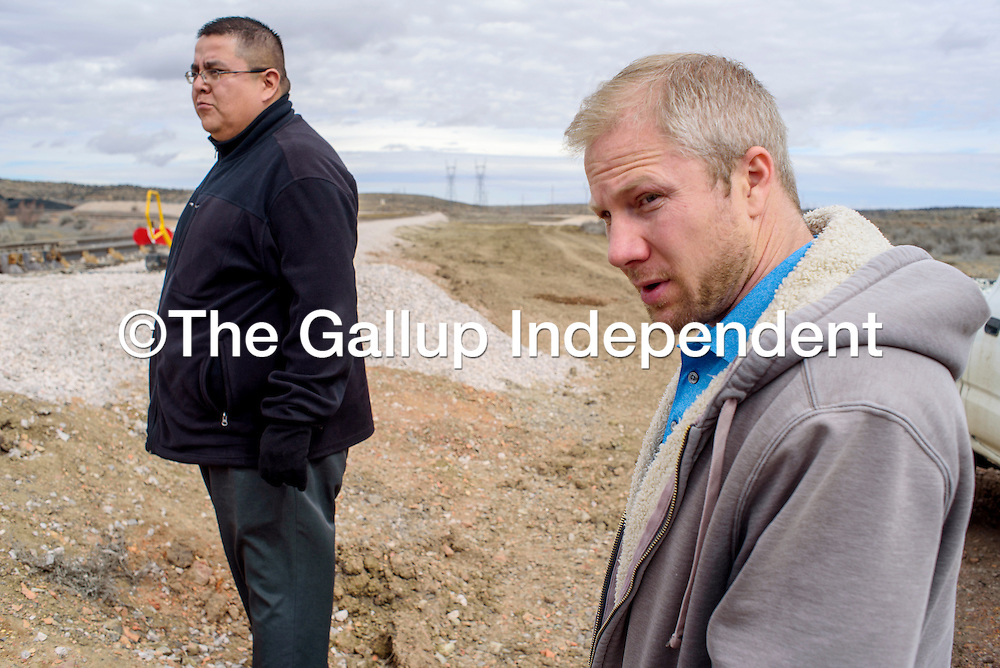 Adam Wilkey, right, with Gallup Land Partners and Michael Sage of Greater Gallup tour the phase one construction at the Gallup Land Partners development near Mentmore Wednesday.
