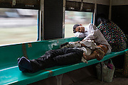 Passengers resting on Yangon Circular Train