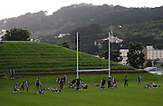 The All Blacks stretch during their warm-up.<br /> All Blacks Training Session at Rugby League Park, Newtown, Wellington. Tuesday 3 June 2008. Photo: Dave Lintott/PHOTOSPORT
