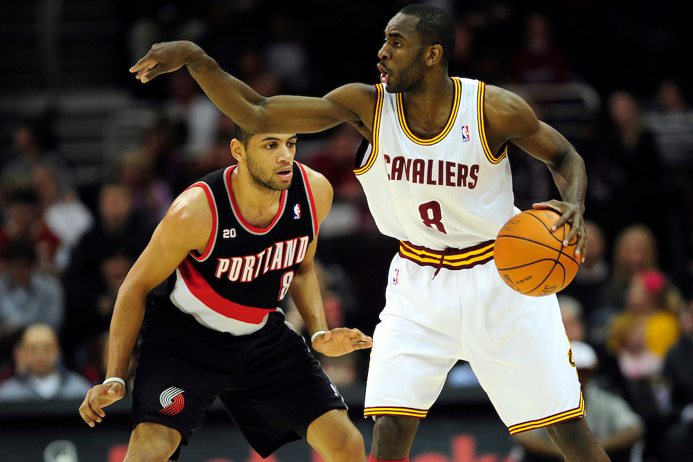 Feb. 5, 2011; Cleveland, OH, USA; Cleveland Cavaliers guard Christian Eyenga (8) yells to his teammates under pressure from Portland Trail Blazers point guard Patrick Mills (8) during the first quarter at Quicken Loans Arena. Mandatory Credit: Jason Miller-US PRESSWIRE
