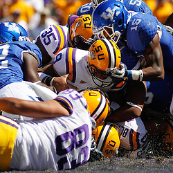 October 1, 2011; Baton Rouge, LA, USA;  LSU Tigers quarterback Jordan Jefferson (9) scores a touchdown on a quarterback sneak past Kentucky Wildcats defenders linebacker Danny Trevathan (22) and safety Martavius Neloms (15) during the first quarter at Tiger Stadium.  Mandatory Credit: Derick E. Hingle-US PRESSWIRE / © Derick E. Hingle 2011