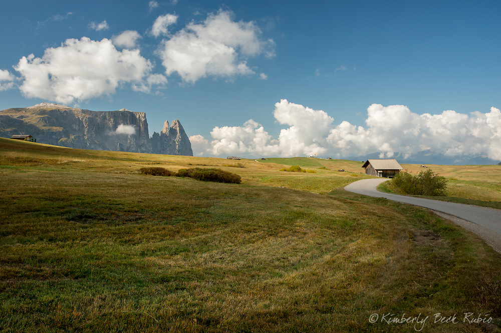 Sciliar Massif high above Alpi di Siusi farmland, the highest plateau in Europe. Dolomite Mountains, Italy,