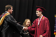 Board of Education president Chip Bonny (left) shakes hands with new graduate Jonathan Charles Duffy during the 142nd annual Lebanon High School commencement at the Nutter Center in Fairborn, Saturday, May 26, 2012.