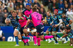 Exeter Winger (#14) Matt Jess hands off Cardiff Blues Hooker (#2) Matthew Rees (capt) during the first half of the match - Photo mandatory by-line: Rogan Thomson/JMP - Tel: 07966 386802 - 13/10/2013 - SPORT - RUGBY UNION - Sandy Park, Exeter - Exeter Chiefs v Cardiff Blues - Heineken Cup Round 1.