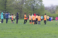 """8927 – AYSO Youth Soccer League players take a break Saturday afternoon during soccer practice in Jackson Park Saturday afternoon in Jackson Park.<br /> <br /> Please 'Like' """"Spencer Bibbs Photography"""" on Facebook.<br /> <br /> All rights to this photo are owned by Spencer Bibbs of Spencer Bibbs Photography and may only be used in any way shape or form, whole or in part with written permission by the owner of the photo, Spencer Bibbs.<br /> <br /> For all of your photography needs, please contact Spencer Bibbs at 773-895-4744. I can also be reached in the following ways:<br /> <br /> Website – www.spbdigitalconcepts.photoshelter.com<br /> <br /> Text - Text """"Spencer Bibbs"""" to 72727<br /> <br /> Email – spencerbibbsphotography@yahoo.com"""