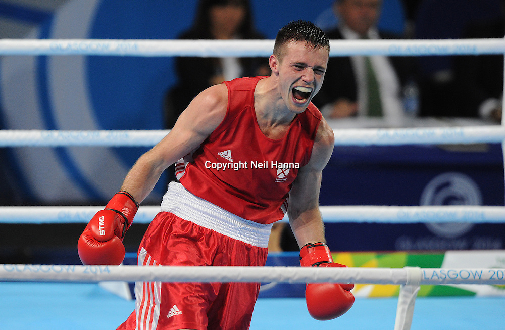 Commonwealth Games, Glasgow 2014<br /> Men's Welter Weight Final<br /> <br /> Josh Taylor wins Scotland's second Gold medal of the day.<br /> <br /> Josh Taylor of Scotland v Junias Jones of NAM<br /> <br />  Neil Hanna Photography<br /> www.neilhannaphotography.co.uk<br /> 07702 246823