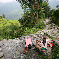Surrounded by the terrai and climbing hills of the Annapurna Mountains of Nepal, local villagers capitalize on the streams that creep down the mountains to wash clothes and bath Sept. 22, 2009.