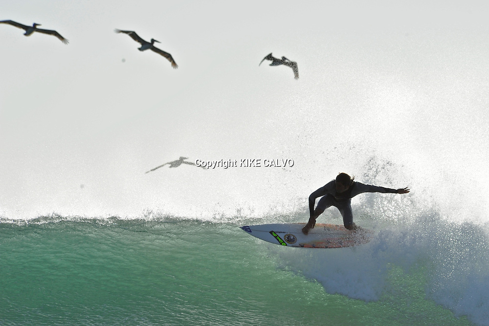 Surfing at Playa Grande, within Las Baulas National Park. The park supports the largest nesting colony of leatherback turtles in the Pacific Ocean.