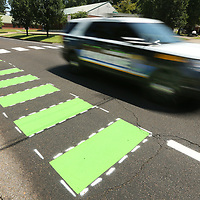 A Tupelo Police car drives past one of the newly added bike lanes on Joyner Ave. Friday afternoon.