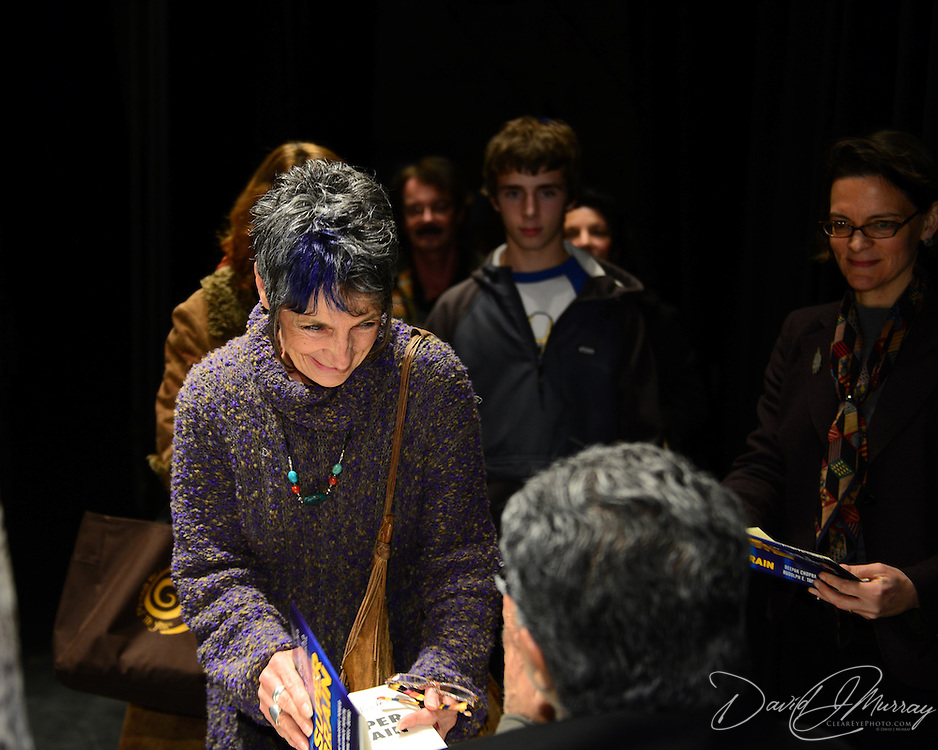 Audience members at a backstage book signing with Dr. Deepak Chopra after he spoke at The Music Hall in Portsmouth, NH.