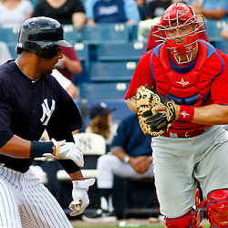 March 11, 2012; Tampa Bay, FL, USA; New York Yankees center fielder Chris Dickerson (41) is run down by Philadelphia Phillies catcher Erik Kratz (31)  during the bottom of the third inning of a spring training game at George M. Steinbrenner Field. Mandatory Credit: Derick E. Hingle-US PRESSWIRE