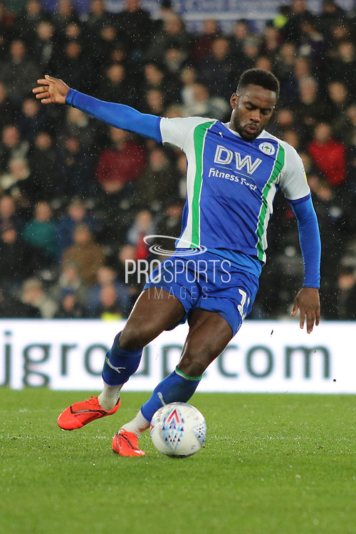 Wigan Athletic forward Gavin Massey scores the opening goal during the EFL Sky Bet Championship match between Derby County and Wigan Athletic at the Pride Park, Derby, England on 5 March 2019.