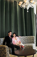 Couple sitting in hotel lobby