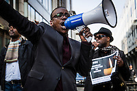 Brussels April 9 2015. A group of Congolese protesters in Brussels gathered in front of the RDC Congolese embassy. they asked for attention of the killed students in the university of Kenya and were angry all attention went to the Charlie Hebdo attacks and not to this terrorist attack. a massgrave found in maluku, next to kinshasha was another reason to protest against Kabila.A man holds a paper with the massgrave in Kinshasa, Maluku.