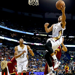 Nov 22, 2013; New Orleans, LA, USA; New Orleans Pelicans shooting guard Eric Gordon (10) shoots over Cleveland Cavaliers center Anderson Varejao (17) during the first quarter of a game at New Orleans Arena. Mandatory Credit: Derick E. Hingle-USA TODAY Sports