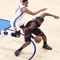 14 June 2012: Oklahoma City Thunder shooting guard Thabo Sefolosha (2) defends on Miami Heat small forward LeBron James (6) during the Miami Heat 100-96 victory over the Oklahoma City Thunder, in Game 2 of the 2012 NBA Finals, at the Chesapeake Energy Arena, Oklahoma City, Oklahoma, USA.