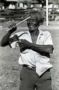 Madman with flute in Port Antonio