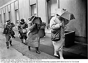 Ladies in the rain. Manhattan. 1992.<br />© Copyright Photograph by Dafydd Jones<br />66 Stockwell Park Rd. London SW9 0DA<br />Tel 0171 733 0108