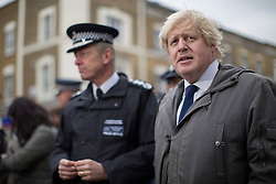 © licensed to London News Pictures. London, UK 25/03/2013.The Mayor of London Boris Johnson (right) and Metropolitan Police Service Commissioner Sir Bernard Hogan-Howe join members of the Dalston Safer Neighbourhood Team on their local beat to launch the Mayor's Police and Crime Plan on Dalston Kingsland High Street in London. Photo credit: Tolga Akmen/LNP