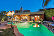 """Mötley Crüe drummer Tommy Lee's home - From heavy metal to Zen paradise<br /> <br /> He is the drummer for the heavy metal band Mötley Crüe, he was once married to Baywatch babe Pamela Anderson, but the wild man of rock'n'roll Tommy Lee likes to come home to a Zen paradise.<br /> <br /> His home in Calabasas is filled with countless Buddha statues and oriental lampshades, and it features an indoor koi pond and towering stalks of bamboo in the open-plan living, dining and entertaining space. <br /> <br /> This space, a two story atrium, cleverly features a retractable glass ceiling. Other features includes a carved stone fireplace in the step-down """"formal"""" living room with its baby grand piano, a lighted sign demanding guests """"EAT"""" in the dining room,  and a VIP nightclub themed lounge with purple and black brocade wallpaper.<br /> <br /> The three story mansion is a substantial 928 sq.m with  five bedrooms and six bathrooms. It also features and office with a private terrace, a stone-walled wine cellar, and a home theatre with full bar and brown leather seats. <br /> <br /> The master bedroom is full rock'n'roll with jet black wall-to-wall carpeting, black walls and a blood-red ceiling. The master bathroom features red brocade wallpaper and a mirrored ceiling.<br /> <br /> The property is situated on a .11 hectare hilltop in a gated community with views over the San Fernando Valley. Underground, there's a 278 sq.m garage of which two-thirds has been converted into a state-of-the-art recording studio with two live booths.  It is currently on the market for US$ $5,995,000.<br /> ©Exclusivepix Media"""