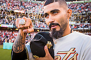 SAN FRANCISCO, CA - APRIL 18:  Sergio Romo #54 of the San Francisco Giants shows off  his  2014 World Series ring during the San Francisco Giants World Series ring ceremony at AT&T Park on Saturday, April 18 2015 in San Francisco, California. Photo by Jean Fruth