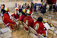 Middletown, New York - Girls in traditional costumes sit in the gymnasium at St. Joseph's Church before marching through the city during the festival of Nuestra Senora de Guadalupe on Sunday, Dec. 9, 2012.