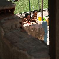 Children playing water games. Santa Marta Community, Rio
