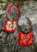 "In Japan, Buddhist statues of Jizo (or respectfully Ojizo-sama) can sometimes be seen wearing tiny children's clothing or red bibs, or with toys, placed by grieving parents to protect their lost ones. Ojizo-sama is one of the most loved of Japanese divinities. His features are commonly made more baby-like to resemble the children he protects. His statues are a common sight along roadsides and graveyards. Traditionally, he is seen as the guardian of children, and in particular, children who died before their parents. Jizo has been worshipped as the guardian of the souls of mizuko, the souls of stillborn, miscarried or aborted fetuses (""water children""). Jizo is a Japanese version of Ksitigarbha (Sanskrit for ""Earth Treasury"", ""Earth Store"", ""Earth Matrix"" or ""Earth Womb""), a bodhisattva revered in East Asian Buddhism. Ksitigarbha is usually depicted as a Buddhist monk with a halo around his shaved head. He carriesa staff to force open the gates of hell and a wish-fulfilling jewel to light up the darkness. Kurama-dera is a peaceful Buddhist temple along the steep wooded mountainside above the rural town of Kurama, in the northern mountains of Kyoto City (Kyoto-fu), Japan. A cablecar takes you halfway up the mountain.  In September 2018, a typhoon snapped trees and extensively damaged the grounds of Kurama Temple. During our visit in November, the cablecar was required to reach walking trails to the main hall; and the steep 1-hour hiking trail between Kurama and Kibune was closed until further notice."