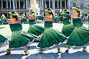 Young girls perform the hula in front of the King Kamehameha statue in Honolulu.