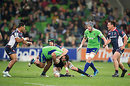 Ma'afu Fia (Highlanders) is tackled by Hugh Pyle (Rebels) during the Round 17 match of the 2013 Super Rugby Championship between RaboDirect Rebels vs Highlanders at AAMI Park, Melbourne, Victoria, Australia. 12/07/0213. Photo By Lucas Wroe