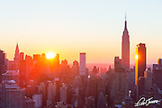 Aerial view of midtown manhattan at sunrise showing the Empire State Building and the Chrysler Building, photographed from a helicopter.