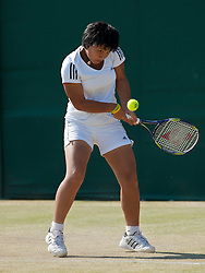 LONDON, ENGLAND - Monday, June 28, 2010: Luksika Kumkhum (THA) during the Girls' Singles 1st Round match on day seven of the Wimbledon Lawn Tennis Championships at the All England Lawn Tennis and Croquet Club. (Pic by David Rawcliffe/Propaganda)