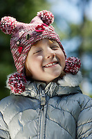 Portrait of girl (5-6) in winter clothes smiling