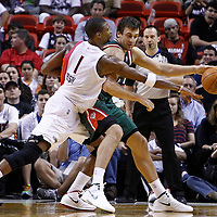 22 January 2012: Miami Heat power forward Chris Bosh (1) defends on Milwaukee Bucks center Andrew Bogut (6) during the Milwaukee Bucks 91-82 victory over the Miami Heat at the AmericanAirlines Arena, Miami, Florida, USA.
