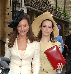 KATE MIDDLETON (white suit) at the wedding of Hugh van Cutsem to Rose Astor in Burford, Oxfordshire on 4th June 2005.<br />