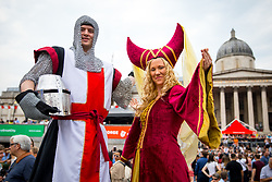 © Licensed to London News Pictures. 21/04/2018. London, UK. A man dressed as St George (left) attends the 'Feast of St George' event in Trafalgar Square, to celebrate the Patron Saint of England. St George's Day is on 23 April. Photo credit : Tom Nicholson/LNP